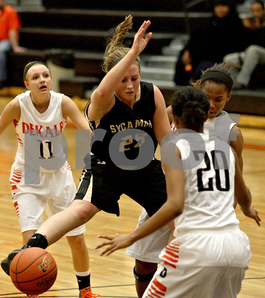 Monica Maschak - mmaschak@shawmedia.com<br /> Bailey Gilbert loses the ball in a scoring attempt in the fourth quarter on Friday, December 13, 2013. The Spartans beat the Barbs 32-29.