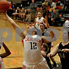 Monica Maschak - mmaschak@shawmedia.com<br /> Alexis Hammond possesses the rebound in the third quarter on Friday, December 13, 2013. The Spartans beat the Barbs 32-29.