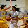 Monica Maschak - mmaschak@shawmedia.com<br /> Samantha Mosley gets caught in the middle in the first quarter against Morris at Indian Creek High School on Tuesday, December 10, 2013. The Timberwolves lost, 68-47.