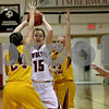 Monica Maschak - mmaschak@shawmedia.com<br /> Emma Goodrich looks for an open teammate in the third quarter against Morris at Indian Creek High School on Tuesday, December 10, 2013. The Timberwolves lost, 68-47.