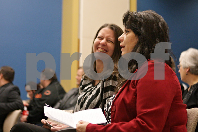 Rob Winner – rwinner@shawmedia.com<br /> <br /> Julie Cummings (front) and Tara King of the Choosing Life and Ending Abuse Now (CLEAN) Slate Alumni Association of DeKalb County Drug/DUI Court share a laugh before the program's eleventh graduation ceremony at the Gathertorium inside the DeKalb County Legislative Building in Sycamore, Ill., Friday, Dec. 6, 2013.