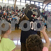 Rob Winner – rwinner@shawmedia.com<br /> <br /> Staley Da Bear high-fives a group of students at Hiawatha Elementary School in Kirkland, Ill., during a visit as part of the Chicago Bears Tackle Reading program on Tuesday, Dec. 10, 2013.
