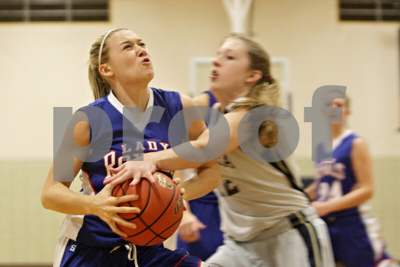 Rob Winner – rwinner@shawmedia.com<br /> <br /> Hinckley-Big Rock's Jacqueline Madden (left) drives to the basket for two points past Hiawatha defender Alanna Sterling during the first quarter in Kirkland, Ill., Monday, Dec. 9, 2013.
