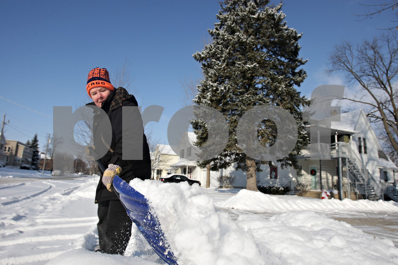 Rob Winner – rwinner@shawmedia.com<br /> <br /> DeKalb resident Connie Schorsch removes snow using a shovel from the end of her driveway on the 300 block of Fisk Avenue on Wednesday, Dec. 11, 2013.