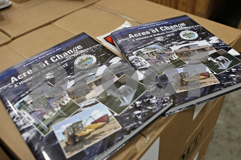"""Rob Winner – rwinner@shawmedia.com<br /> <br /> The """"Acres of Change"""" history book arrived in print at Blackhawk Moving and Storage in Sycamore, Ill., Thursday, Dec. 12, 2013."""