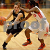 Monica Maschak - mmaschak@shawmedia.com<br /> Lauren Goff steers toward the hoop in the second quarter on Friday, December 13, 2013. The Spartans beat the Barbs 32-29.