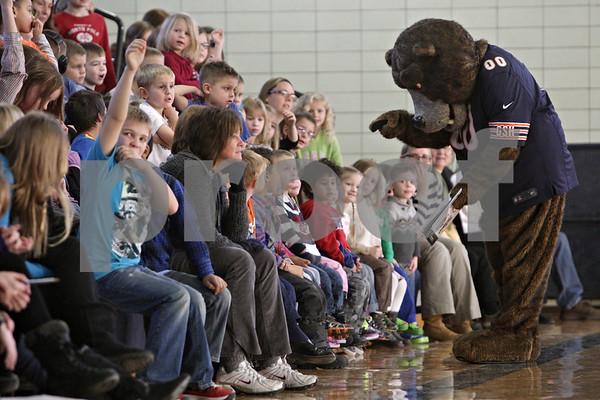 Rob Winner – rwinner@shawmedia.com<br /> <br /> Staley Da Bear visits with students at Hiawatha Elementary School in Kirkland, Ill., as part of the Chicago Bears Tackle Reading program on Tuesday, Dec. 10, 2013.