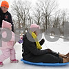 Rob Winner – rwinner@shawmedia.com<br /> <br /> The Haberkamp family of Genoa, including Brian (from left to right), Kailey Lynn, 2, and Krista, spend the afternoon sledding at Russell Woods in Genoa, Ill., Thursday, Dec. 19, 2013. It had been over 20 years since Krista had last gone sledding at the hill after she crashed and received eight stitches below her chin. For Kailey Lynn it was her first sledding experience.