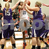 Monica Maschak - mmaschak@shawmedia.com<br /> DeKalb's Ashlei Lopez leaps to the hoop in the first quarter against Rochelle at DeKalb High School on Friday, December 20, 2013. The Barbs won, 70-39.