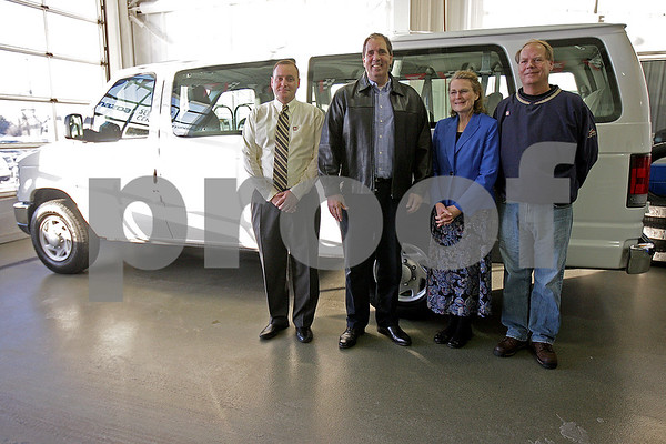 Monica Maschak - mmaschak@shawmedia.com<br /> Pastor William Mills, Ruth O'Donnell and Larry Euhus (right three) from Network of Nations, a local nonprofit that supports international students at NIU, picks up a 15-passenger van they received thanks to a grant from the DeKalb County Community Foundation on Tuesday, December 17, 2013. Also photographed: Marc Wasser (left), Director of Brian Bemis Auto Group.