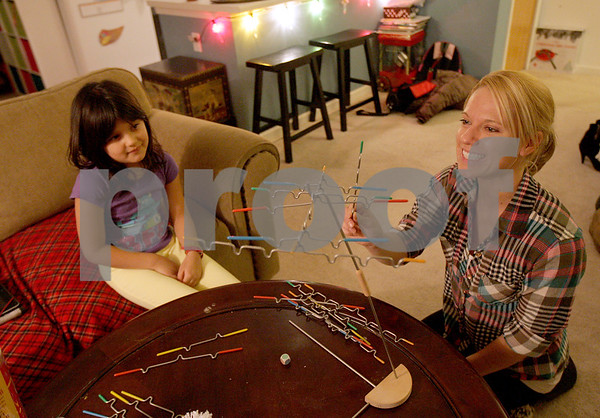 Monica Maschak - mmaschak@shawmedia.com<br /> Jackie DeCleene and her seven-year-old daughter, Anaya DeCleene, play a game called Suspend (similar to Jenga) on Wednesday, December 18, 2013. The DeCleenes like to focus at least one night a week doing activities together that do not involve smart technologies.