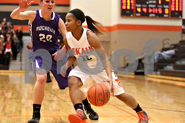 Monica Maschak - mmaschak@shawmedia.com<br /> DeKalb's Brittney Patrick dribbles in the first quarter against Rochelle at DeKalb High School on Friday, December 20, 2013. The Barbs won, 70-39.
