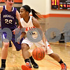 Monica Maschak - mmaschak@shawmedia.com<br /> DeKalb's Brittney Patrick dribbles in the first quarter against Rochelle at DeKalb High School on Friday, December 20, 2013. The Barbs won, 70-39.