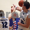 Monica Maschak - mmaschak@shawmedia.com<br /> Tommy Lucca loses the ball on a layup attempt in the second quarter against Burlington Central on Thursday, December 19, 2013. The Cogs beat the Rockets, 62-59.