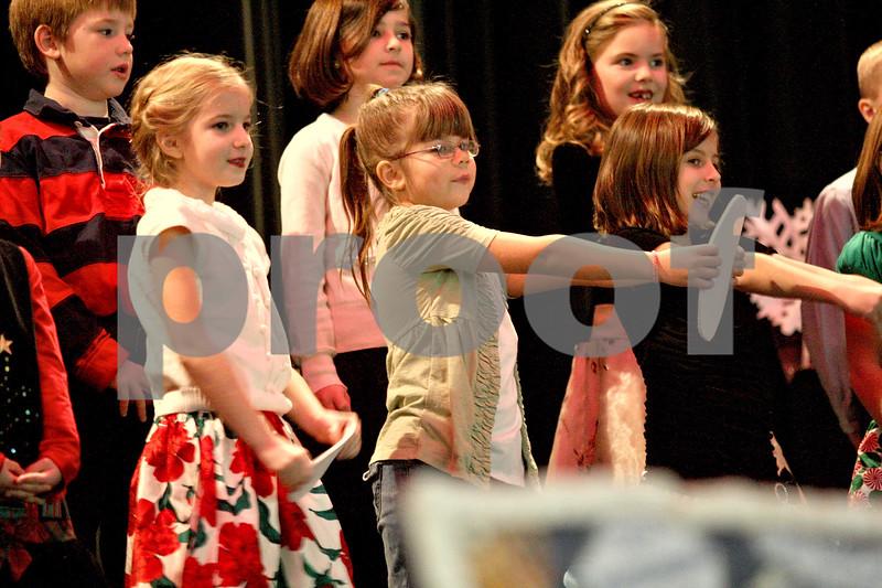 """Monica Maschak - mmaschak@shawmedia.com<br /> Mrs. Foster's second grade class performs """"Marshmallow World"""" during Waterman Elementary School's winter music program at Indian Creek High School on Tuesday, December 17, 2013."""
