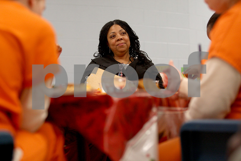 Monica Maschak - mmaschak@shawmedia.com<br /> Rhonda Keller, a parenting instructor, listens to her inmates' celebrations and regrets from the past week at the DeKalb County Jail on Tuesday, December 17, 2013. This week, the inmates were able to make a Christmas craft for a loved one.