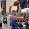 Monica Maschak - mmaschak@shawmedia.com<br /> Griffin McNeal shoots over a defender in the first quarter against Burlington Central on Thursday, December 19, 2013. The Cogs beat the Rockets, 62-59.