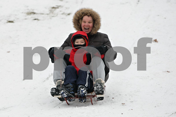Rob Winner – rwinner@shawmedia.com<br /> <br /> Annette Johnson and her son Iker, 8, enjoy the afternoon sledding at Russell Woods Forest Preserve in Genoa, Ill., Thursday, Dec. 19, 2013. Johnson, who was born and raised in DeKalb, now lives in Spain and is visiting her parents for a few months with her family.<br /> <br /> ***The family lives in Granada, but I wasn't sure if that was necessary to note***