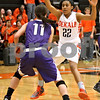 Monica Maschak - mmaschak@shawmedia.com<br /> DeKalb's Ashlei Lopez posts up in front of an offender in the fourth quarter against Rochelle at DeKalb High School on Friday, December 20, 2013. The Barbs won, 70-39.