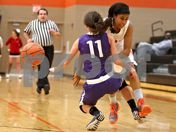 Monica Maschak - mmaschak@shawmedia.com<br /> DeKalb's Ashlei Lopez crashes into a defender in the first quarter against Rochelle at DeKalb High School on Friday, December 20, 2013. The Barbs won, 70-39.
