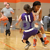 Monica Maschak - mmaschak@shawmedia.com<br /> DeKalb's Ashlei Lopez crashes into a defender in the first quarter against Rochelle at DeKalb High School on Friday, December 20, 2013. The Barbs won, 70-39.