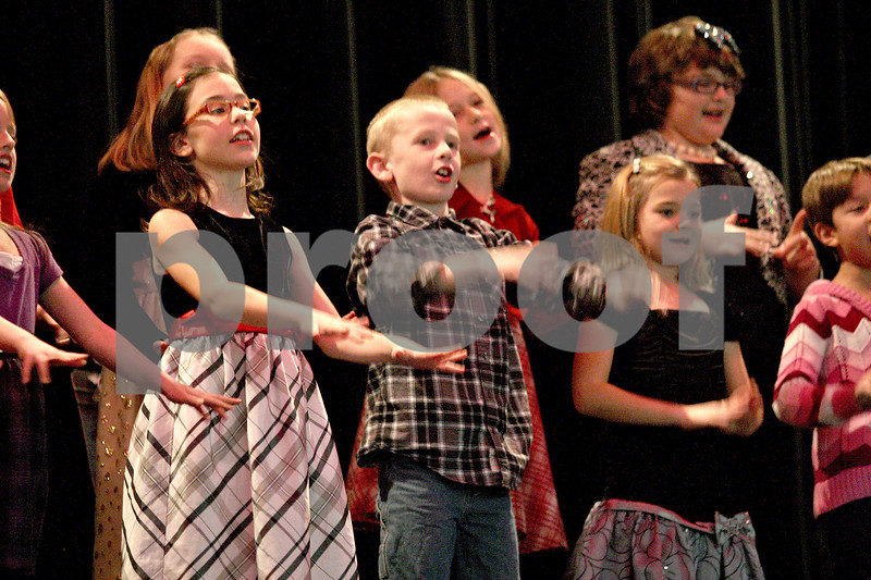 "Monica Maschak - mmaschak@shawmedia.com<br /> Mrs. Lovett's third grade class performs ""Huron Carol"" and ""Take Me Out in a Snowstorm"" during Waterman Elementary School's winter music program at Indian Creek High School on Tuesday, December 17, 2013."