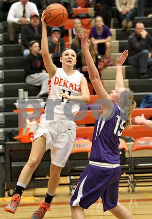 Monica Maschak - mmaschak@shawmedia.com<br /> DeKalb's Paige Wogen attempts a shot in the second quarter against Rochelle at DeKalb High School on Friday, December 20, 2013. The Barbs won, 70-39.
