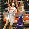 Monica Maschak - mmaschak@shawmedia.com<br /> DeKalb's Paige Wogen attempts a shot in the second quarter against Rochelle at DeKalb High School on Friday, December 20, 2013. The Barbs won, 70-39.