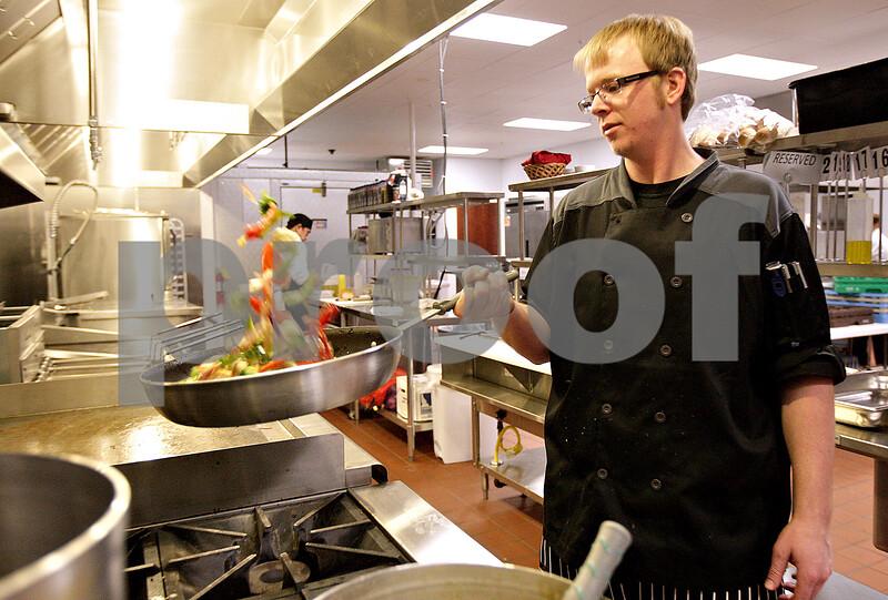 Monica Maschak - mmaschak@shawmedia.com<br /> Head Chef Andrew Klatt tosses some fire roasted vegetables in a pan to prepare for a holiday party at Faranda's in DeKalb on Saturday, December 14, 2013.