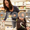 Monica Maschak - mmaschak@shawmedia.com<br /> Megan Jackson picks out some groceries with her one-year-old son, Cameron Jackson, at Schnuck's in DeKalb on Saturday, December 14, 2013. Jackson is in the WIC program.