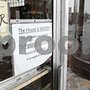 Rob Winner – rwinner@shawmedia.com<br /> <br /> A sign noting that The House Cafe will be opening again is seen on the business's front door in DeKalb, Ill., Monday, Dec. 16, 2013.
