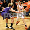 Monica Maschak - mmaschak@shawmedia.com<br /> DeKalb's Paige Wogen looks to pass in the third quarter against Rochelle at DeKalb High School on Friday, December 20, 2013. The Barbs won, 70-39.
