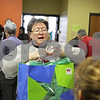 Rob Winner – rwinner@shawmedia.com<br /> <br /> Carolyn Law helps wrap gifts during the Marine Corps Toys for Tots distribution event at the Salvation Army in DeKalb, Ill., Tuesday, Dec. 17, 2013. Law was volunteering with other members of Mayfield Church in rural Sycamore.