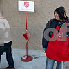 Monica Maschak - mmaschak@shawmedia.com<br /> Alex Vega, with the Salvation Army, greets customers walking into the DeKalb Walmart on Wednesday, December 11, 2013. The money donated to the Salvation Army around the holidays sustains the charitable organization year round.