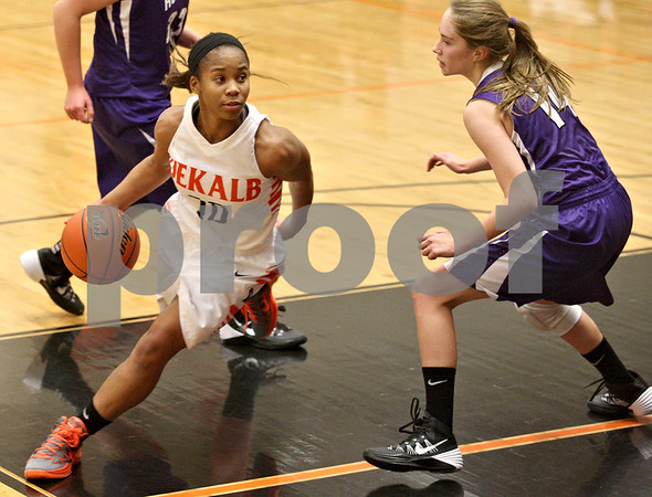 Monica Maschak - mmaschak@shawmedia.com<br /> DeKalb's Brittney Patrick surveys her options in the third quarter against Rochelle at DeKalb High School on Friday, December 20, 2013. The Barbs won, 70-39.