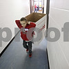 Rob Winner – rwinner@shawmedia.com<br /> <br /> Lars Carlson, 8, of Kirkland helps carry an empty box to the basement during the Marine Corps Toys for Tots distribution event at the Salvation Army in DeKalb, Ill., Tuesday, Dec. 17, 2013.