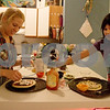 Monica Maschak - mmaschak@shawmedia.com<br /> Jackie DeCleene and her seven-year-old daughter, Anaya DeCleene, make pizzas for dinner on Wednesday, December 18, 2013. The DeCleenes like to focus at least one night a week doing activities together that do not involve smart technologies.