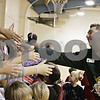 Rob Winner – rwinner@shawmedia.com<br /> <br /> Veteran Service Officer Steve Kreitzer thanks third grade students at Malta Elementary School on Tuesday morning after they made ornaments which will be hung on a Christmas tree at the DeKalb County Veterans Assistance Commission office to honor veterans this holiday season.<br /> <br /> Tuesday, Dec. 17, 2013