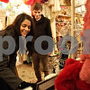 Monica Maschak - mmaschak@shawmedia.com<br /> Danielle Mohr shops for a last-minute Christmas gift for her mother with the help of her boyfriend, Brye Walker, at Crackerjax in DeKalb on Tuesday, December 24, 2013.