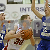 Rob Winner – rwinner@shawmedia.com<br /> <br /> Rockford Christian's Aaron Johnson (34 and Nolan Gazouski (22) pressure Indian Creek's Garrett Post (30) on his way to the basket in the second quarter during their game at the Plano Christmas Classic on Monday, December 23, 2013. RC defeated IC, 36-35.