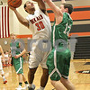 Monica Maschak - mmaschak@shawmedia.com<br /> DeKalb's Dre Brown shoots over a defender in the first quarter of a Chuck Dayton tournament game against Geneseo on Friday, December 27, 2013. The Barbs won, 73-69.