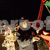 Monica Maschak - mmaschak@shawmedia.com<br /> Ken Copenhaver tends to the Christmas ferris wheel decoration in his Sycamore front yard. Copenhaver and his next-door neighbor are known for their grand display of Christmas lights on Gerry Lane.