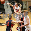 Monica Maschak - mmaschak@shawmedia.com<br /> DeKalb's Ethan Conroy passes in the third quarter against Belvidere during the first day of the Chuck Dayton Tournament on Saturday, December 21, 2013. DeKalb won, 72-68.
