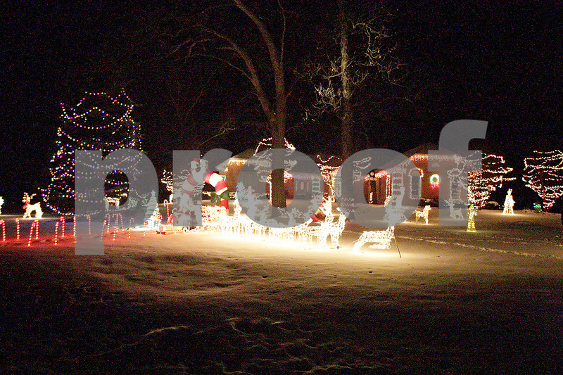 Monica Maschak - mmaschak@shawmedia.com<br /> Two neighboring homes on Gerry Lane in Sycamore boast a grand display of Christmas lights for passerbys to enjoy.