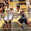 Monica Maschak - mmaschak@shawmedia.com<br /> DeKalb's Rudy Lopez races to the basket in the fourth quarter against Belvidere during the first day of the Chuck Dayton Tournament on Saturday, December 21, 2013. DeKalb won, 72-68.