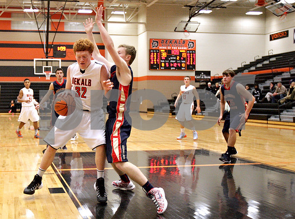 Monica Maschak - mmaschak@shawmedia.com<br /> DeKalb's Micah Fagerstrom nudges his way to the paint in the second quarter against Belvidere during the first day of the Chuck Dayton Tournament on Saturday, December 21, 2013. DeKalb won, 72-68.