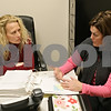 Rob Winner – rwinner@shawmedia.com<br /> <br /> Detectives Jackie Hill (left) and Sarah Frazier of the DeKalb County Sheriff's Office look over a previous case for training purposes in Sycamore, Ill., Friday, Dec. 20, 2013. Frazier investigates domestic violence cases and is returning to patrol in January and training Hill to take over her position.