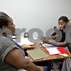 Monica Maschak - mmaschak@shawmedia.com<br /> Business Services Representative Danita Sims, with First Institute, and Prince Montgomery, of DeKalb review Montgomery's resume at the WorkNet Center in DeKalb on Thursday, December 19, 2013.