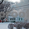 Monica Maschak - mmaschak@shawmedia.com<br /> Smoke billows from a house on fire in DeKalb on Tuesday, December 24, 2013.