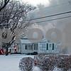 Monica Maschak - mmaschak@shawmedia.com<br /> Smoke billows from a house on fire in DeKalb on Tuesday, December 24, 2013.